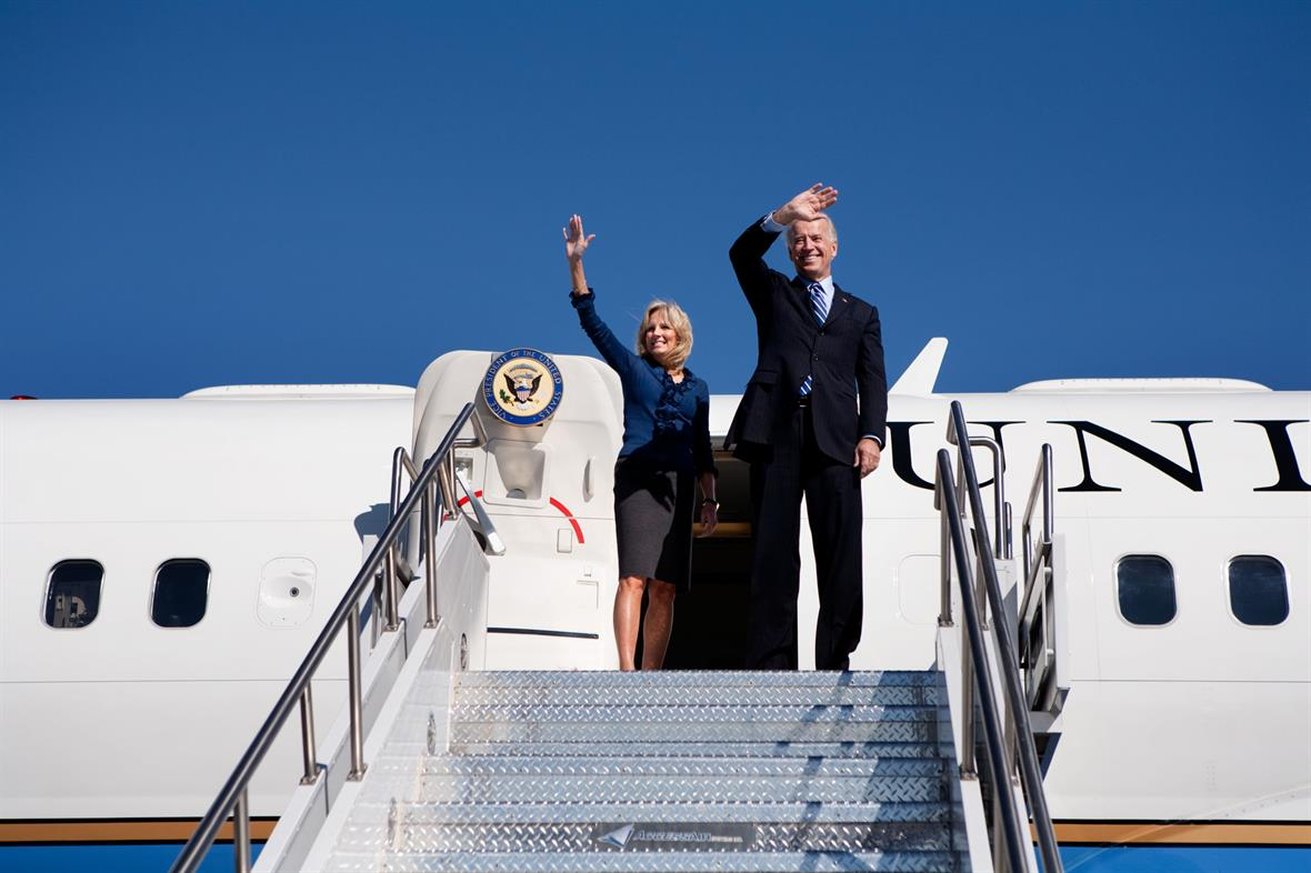 Joe Biden and Jill Biden wave Air Force 2
