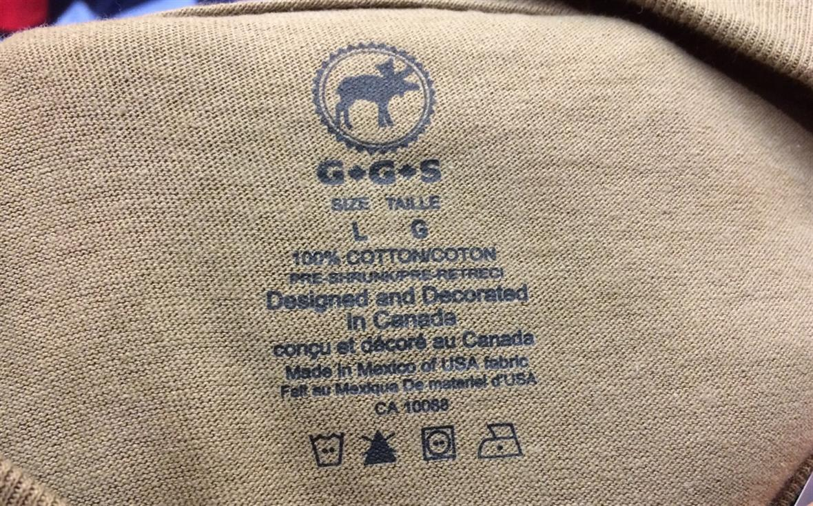 Label indicating sweater was made in Mexico of USA fabric