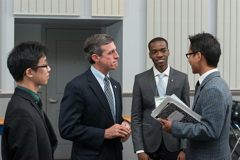 Gov. John Carney networks with Biden School of Public Policy & Administration students.