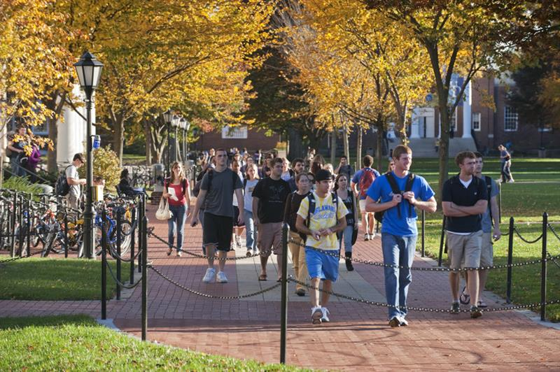 University of Delaware students walk around campus on a sunny day.