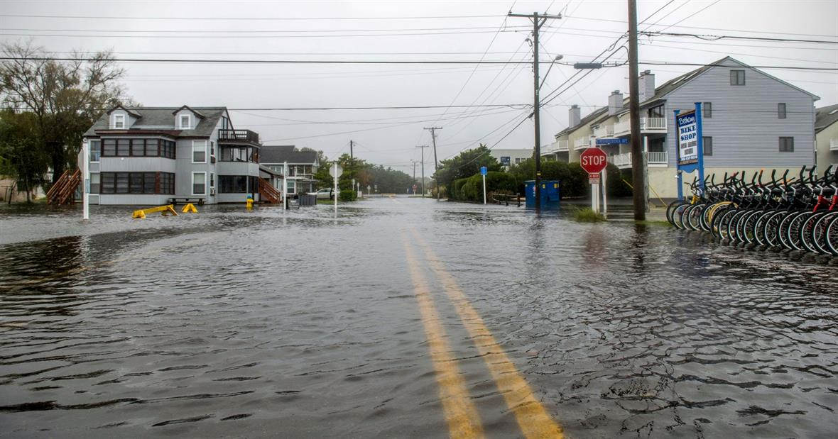 High flood waters fill a town center intersection in Bethany Beach, Delaware.