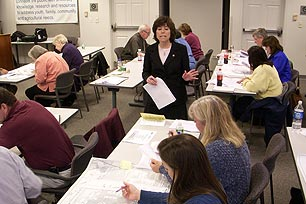 Linda Raab, course instructor, discusses planning strategies with training participants.