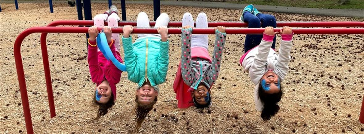 Children hanging on playground