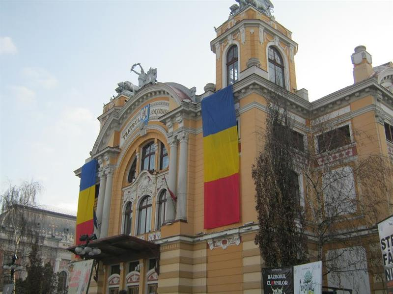 A building with bright banners in Cluj-Napoca, Romania.